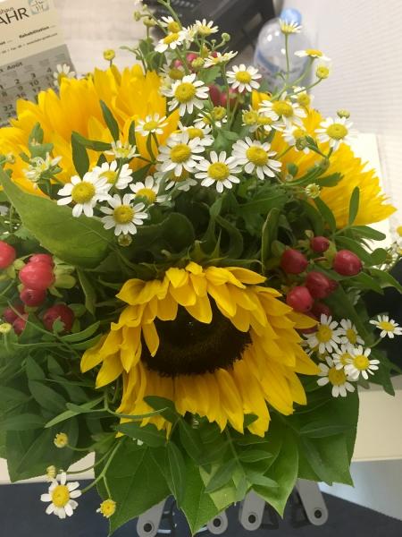 Blumen zum Firmenjubiläum